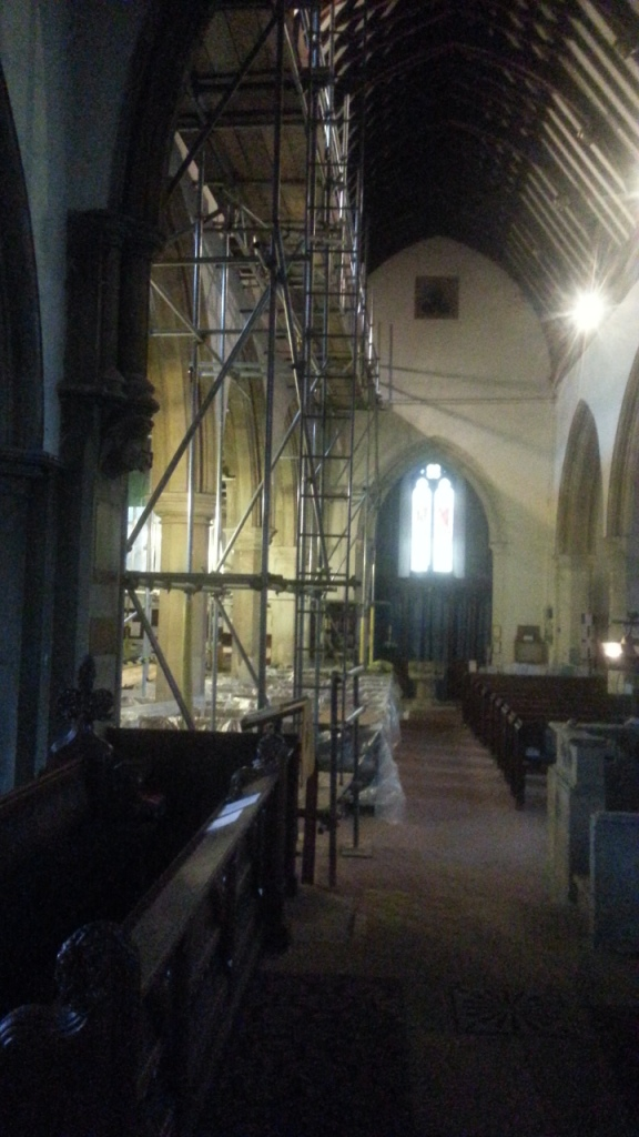 More scaffolding had to be added on the inside, squeezing the rector out of his stall!