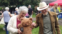 visitors with toy bear